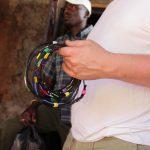Jan Boelo buying accesoiries hand made by the Karamajong on the market in Uganda