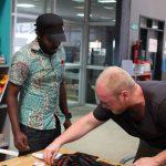 Jan Boelo working with Xenson on fashion designs in Kampala Uganda